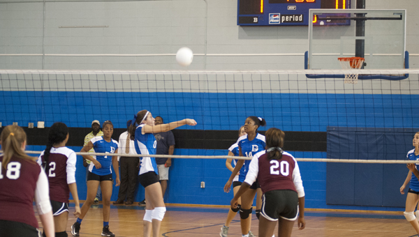 Demopolis High's Jade Montgomery sets up Caleb Washington for a spike in Thursday night's season opening match against Thomasville.