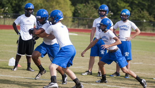 Fall practice started around the state Monday. Demopolis High School held two practices to kick off fall camp. Shown is Tyler Oates working on his handoffs and reads.