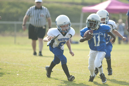 Christopher Baitey runs the ball for the Demopolis rookies. The rookies defeated Northport 14-6.