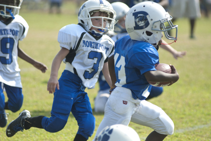 Mason James scored a touchdown for the Demopolis rookies Saturday morning.