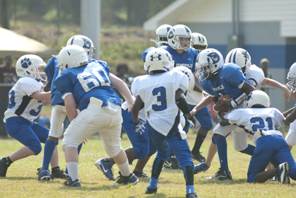 Timothy Thurman II fights for extra yards in the Demopolis juniors game. The juniors defeated Northport 31-0.