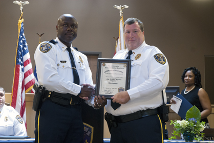Lt. Tim Soronen received his promotion Sunday from DPD Chief Tommie Reese.