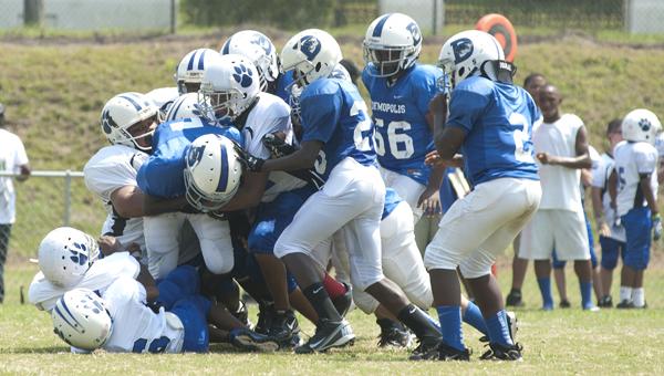 Antonio Besteder Jr. drags a pile forward in the Demopolis youth football seniors game against Northport. The seniors won 32-0.