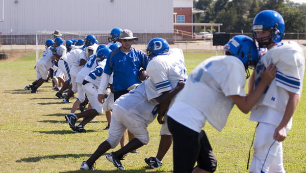 The Demopolis Middle School Tigers prepare for the 2013 season during a practice Monday afternoon. The Tigers open their season on Tuesday, Sept. 3 on the road at Sweet Water.