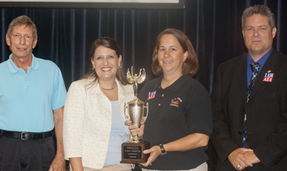 US Jones won this year's SchooFest trophy. Tammy Causey is shown with DCSF Vice President Kim Townsend, Foundation Executive Director Amanda Barnes and Superintendent Al Griffin.