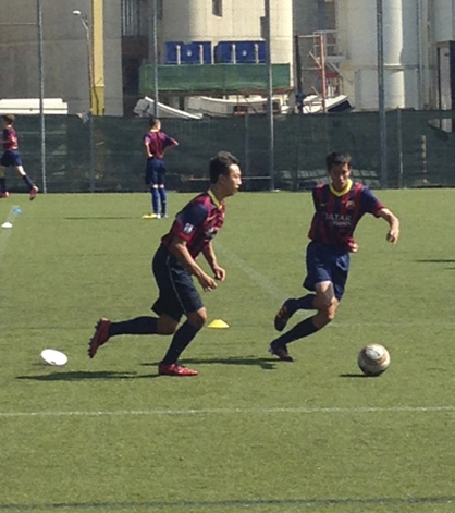 Jeremy Chu participates in a drill during the FCBEscola Camp in Barcelona earlier this summer.