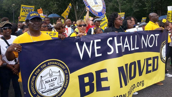 """Demopolis native  Dr. Charles J. Smith Sr., second person on the left with the NAACP cap on, holds the NAACP national lead banner as he participated in the historic March on Washington, D.C., on his 62nd birthday, Aug. 24. The march was to honor the 50th anniversary of Dr. Martin Luther King's """"I Have a Dream"""" speech."""