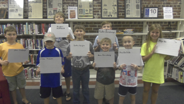 Shown are students from the uppercase cursive writing class. Front, from left to right: Jim Lindsay, Silas Mason, Collin Morgan, Ben Lindsay, Charlie Duke and Miley Lee; back row, left to right: Parker Hallmark and Luke Lindsay.