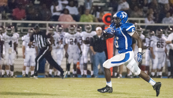 Roderick Davis runs for a touchdown Friday night against Thomasville. He had 12 carries for 244 yards and three touchdowns in the game.