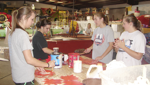 YOUth LEAD members work Wednesday at the Christmas on the River warehouse.
