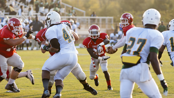 UWA quarterback Kyle Caldwell fakes a handoff to running back Javae Swindle. The Tigers defeated Concordia College 71-14.
