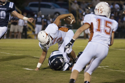 Cason Cook fights for extra yards against Patrician Academy.