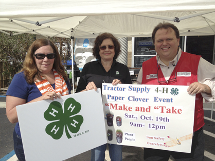 Shown are 4-H agents Lucinda Mason and Susan Thompson as well as Tractor Supply manager Larry Curtis.