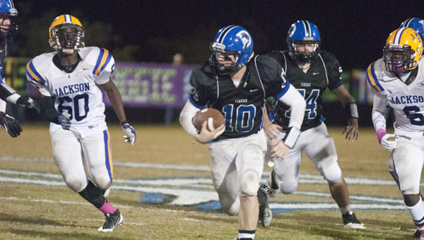 Demopolis quarterback Tyler Oates rushes against Jackson. He had 100 yards on 18 carries in the game.