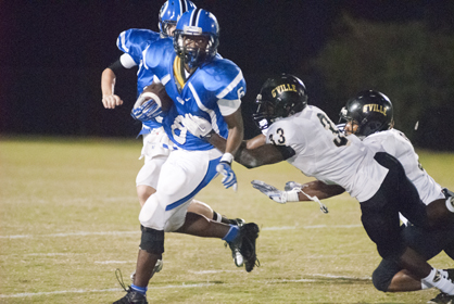 Roderick Davis sheds a tackle and looks up field for extra yards.