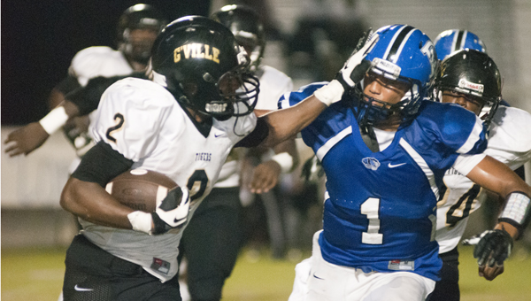 Demopolis senior safety Demetrius Kemp comes in to make a tackle on Greenville's Alyric Posey. Kemp led Demopolis in tackles with 11 total. He also had an interception.