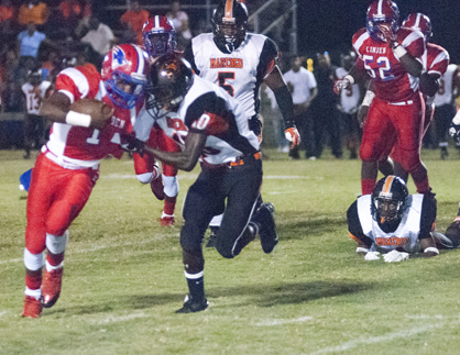 Linden senior Terrance Sanders attempts to break a tackle.
