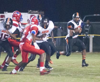 Marengo quarterback Michael Lewis looks for open space against Linden.