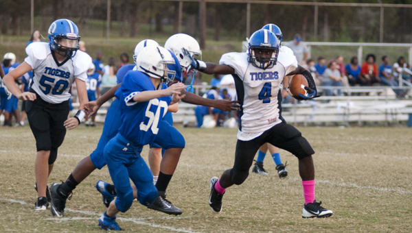 Anthony Jackson finds space in Monday night's game against Wilson Hall Middle School. Jackson had three rushing touchdowns in the 34-6 win.