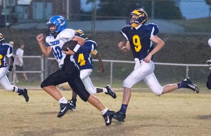 DMS quarterback Russ Logan outruns Sweet Water defenders.