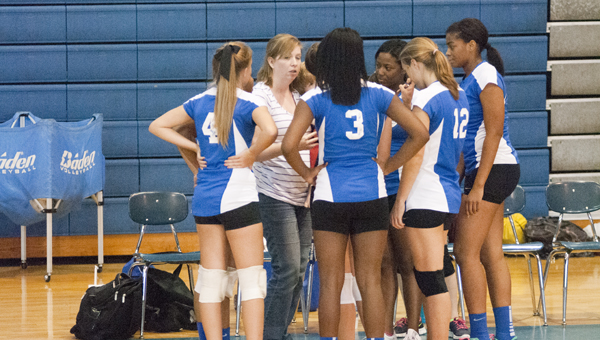 Demopolis head coach Blythe Smith addresses her team during a timeout Tuesday against Selma.