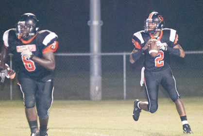 Senior Panthers quarterback Michael Lewis looks for an open receiver.