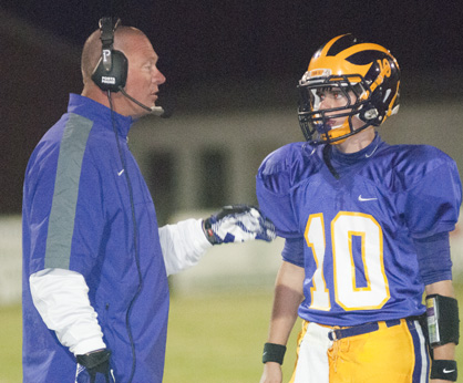 Sweet Water quarterback Branson Davis gets coached up by head coach Stacy Luker.