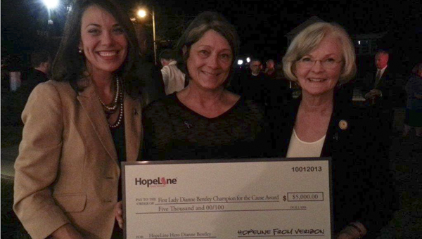 Harriet's House received $15,000 in grants from the Verizon Foundation on Tuesday. Shown are Monica Pate of the Verizon Foundation; Susanna Smith Naisbett, executive director of Harriet's House; and First Lady Dianne Bentley.