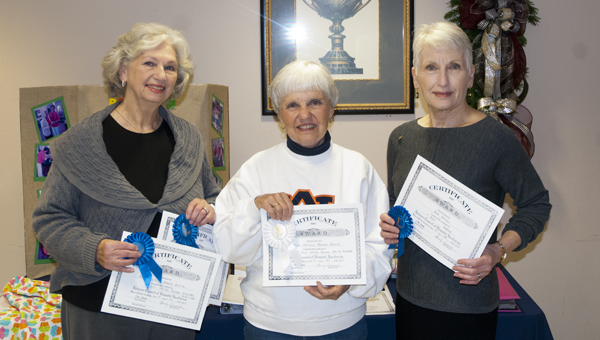 Betty Baxley, Kathy Patterson and Jan McDonald are shown with the Auxiliary's awards from the recent Alabama Council of Hospital Auxiliaries conference.