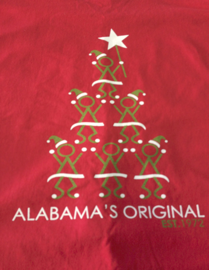 The back of the COTR T-shirt has a design of elves in the shape of a Christmas tree.