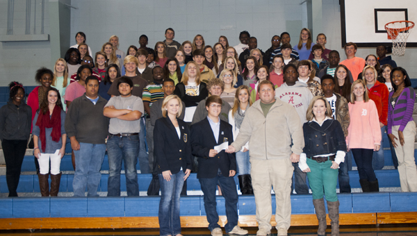 """The Demopolis High School DECA Club presents 17th Judicial Drug Task Force Commander Clint Sumlin with a $1,200 check. The money was raised by the club during their """"Drugs are Scary"""" haunted house on Oct. 25."""