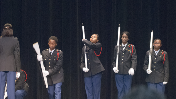 The Demopolis High School JROTC performs a Queen Anne Salute during the Veterans Day program.