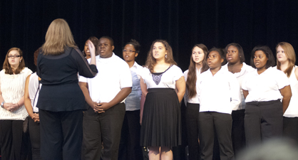 """The DHS choir sang """"My Country, 'Tis of Thee"""" during the program."""