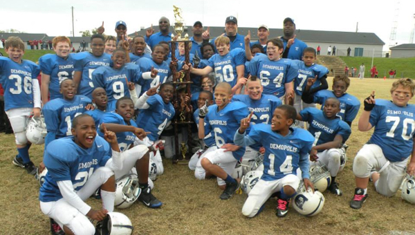 The Demopolis Youth Football League 9/10 team celebrates their second straight championship after defeating Irondale 12-6 Saturday in Tuscaloosa.