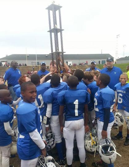 Players hoist the championship trophy.
