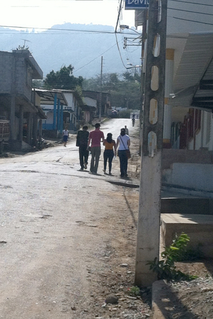 A group of missionaries walk down a Pindal, Ecuador, street during their mission trip in October.