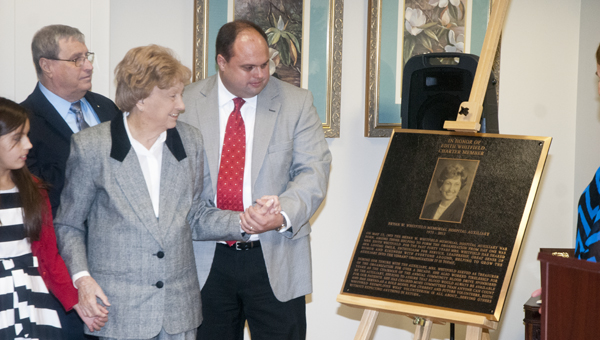 A plaque honoring longtime Bryan W. Whitfield Memorial Hospital Auxiliary volunteer Edith Whitfield was unveiled Thursday.