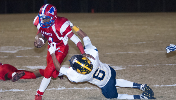 Terrance Sanders breaks a tackle against McKenzie. He had 153 yards and five touchdowns in the game.
