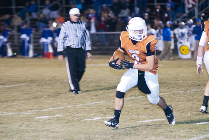 Ralph Langley takes a handoff to the outside Thursday night against Chambers Academy.