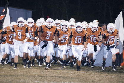 Marengo Academy runs onto the field before the game.