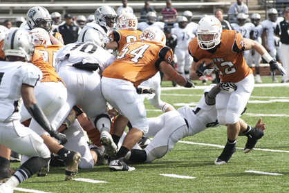 Josh Holifield tries to break a tackle for extra yards.