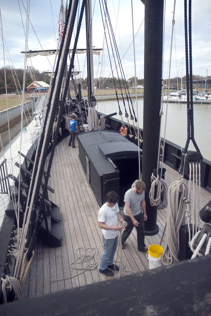Crew members work in The Pinta replica Thursday afternoon.
