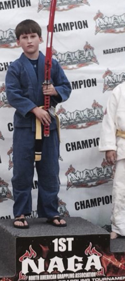 Collin Morgan poses with the championship sword he won in the 8-9 year-old intermediate boys middleweight division at the NAGA Southeast Regional Championships in Riverdale, Ga.