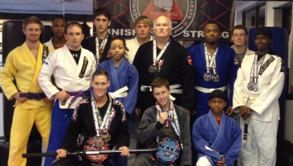 Pictured are members of the Ross Martial Arts Fight Team (left to right): front row - Ronda Russell, Brett Schroeder, Dre Pruitt; second row - Daniel Alexander, A.J. Pruitt, Jay Russell, Tristen Fitz-Gerald, Makiyha Lewis, Anthony Baze, Ron Ross, Franklin Richardson, Ethan Garrick, Nikki Smith. Not pictured are Collin Morgan and Matthew Trest.