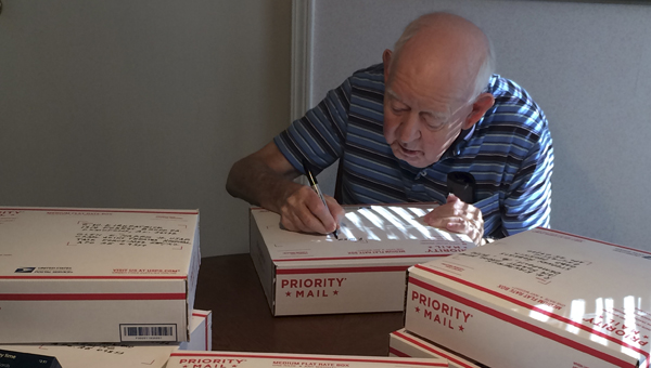 Dick Kirkpatrick personally signs and addresses each letter sent to the troops in the First Presbyterian Church's Christmas Cards for Troops annual campaign.