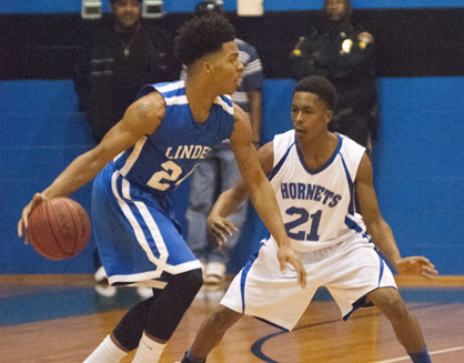 Linden's Imoras Agee makes a move to get around Antwain Gracie of John Essex.