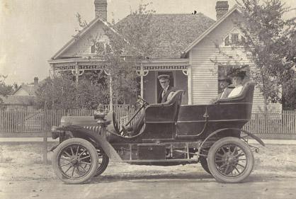 Shown is Robert Hudson in the first car in Demopolis, a 1907 Rambler.