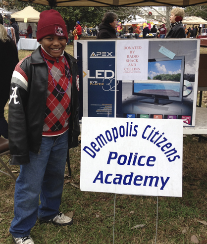 Dexter Boston won a 32-inch TV with a DVD player in the Demopolis Citizen's Police Academy Alumni Association COTR raffle.