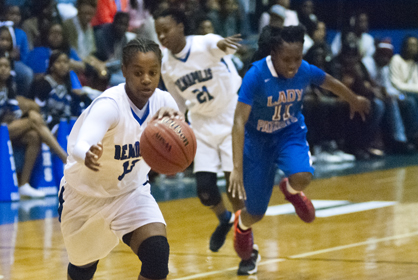 Sha'Deitra White drives the ball down the lane for Demopolis in their win over Linden.