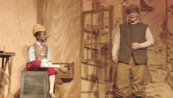Eddie Coats (left) plays Pinocchio and Matt Dollar (right) plays Geppetto in the Canebrake Players' children's production of Pinocchio.